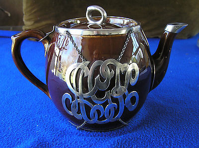 Large brown sterling silver encased teapot, Arts and Crafts