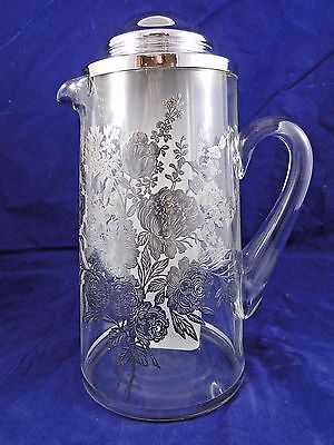1934 Patent Glass Pitcher Carafe W/ Decorative Silver Floral Design Ice Chamber