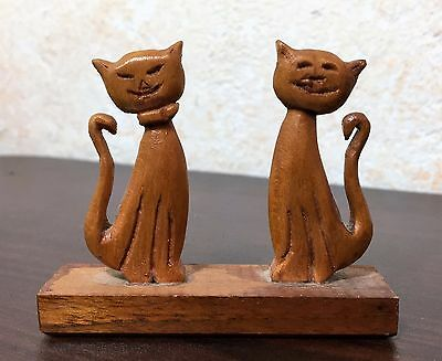 2 Small Hand Carved Wood Cats on Wooden Stand