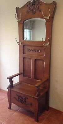 Antique Oak Hall Tree With Carvings Bench Seat Beveled Mirror Hanging Hooks