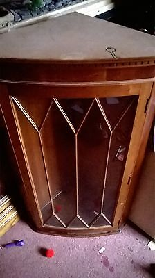 gorgeous contemporary yew wood hanging corner cabinet with astral glazed doors,