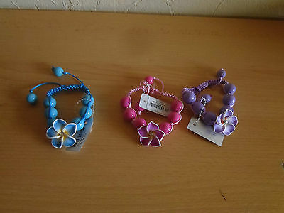 beaded adj bracelets in 4 colours great quality item comes with a flower on