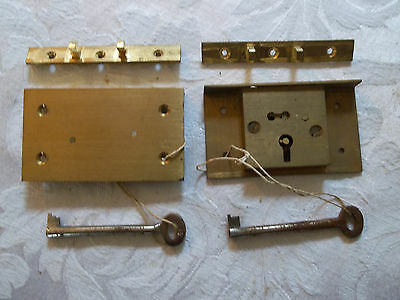 vintage solid brass cabinet/box locks. 2 with 1 key each. top quality.