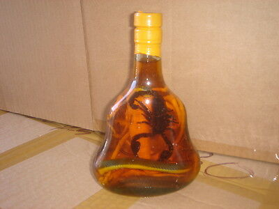 "real cobra snake and a scorpion in a X O glass bottle 7"" tall"