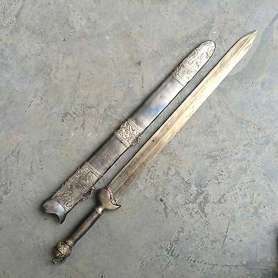 antique   The ancient Chinese bronze sword with scabbard war.