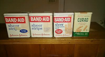Four Vintage Metal Band-Aid Johnson & Johnson Plastic Bandage Tins  with product