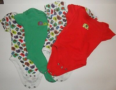 Job Lot (4) of Elephant Themed Baby Bodysuits age 6-9 Months.