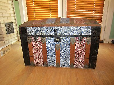 Antique Camel Back Steamer Trunk, colorful stamped metal decoration