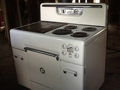 vintage, magestic, wood/electric kitchen cook stove