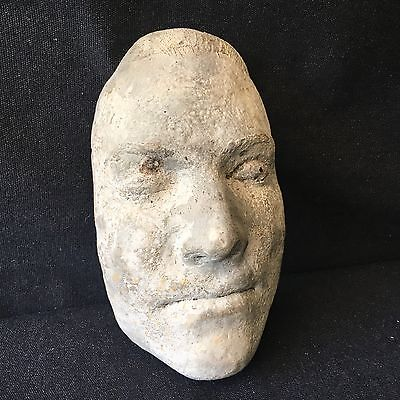 Cast death mask. Concrete cast of male death mask.
