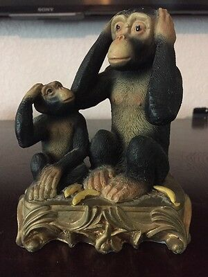 Monkey Hear No Evil with Baby Trying to Mimic Figurine