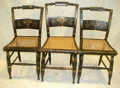 Four 19th century Hitchcock side chairs. Two caned seats need replaced Lot 186