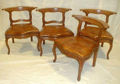 Set of four low wood chairs with brown leather seats. Have flat top b... Lot 153