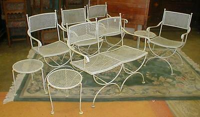 Eight piece iron patio set with settee, four chairs and three side ta... Lot 155
