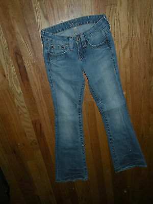 Bebe blue low rise stretch jeans  24  rhinestones back pockets boot cut / flare