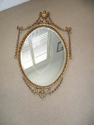 Gold Coloured Framed Oval Wall Mirror In a Baroque Style