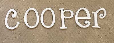 White wooden letters COOPER for nursery or child's room.