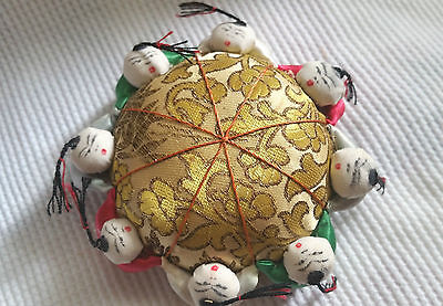 Vintage old Asian PIN CUSHION Has little men dressed in satin fabric around edge