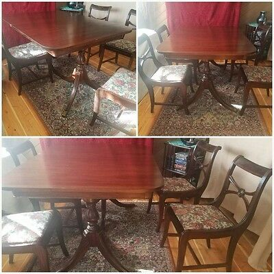 Sweet little antique table for sale $450 has an extension leaf and four chairs40