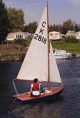 Cadet sailing dinghy with trailer and cover