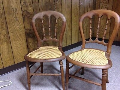 Pair of vintage chairs; wood with cane seat