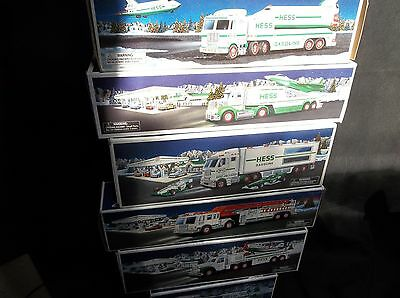 c87 Lot of 6 Assorted Hess Trucks Christmas With Original Boxes Fire Plane Space