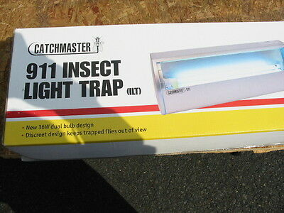 Catchmaster  911 Fly light brand new/ included 1 case of replacement glue boards