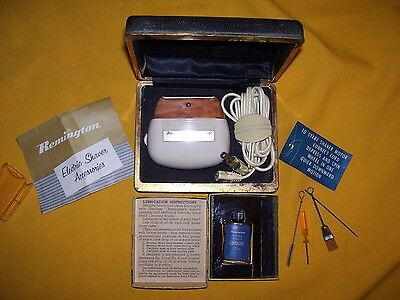 Vintage Remington Deluxe 60 Electric Shaver with Service Kit.