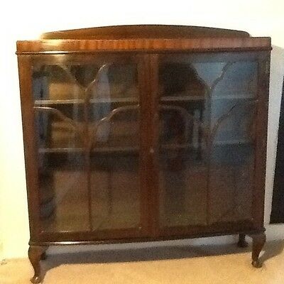 A small pretty bow fronted antique mahogany bookcase