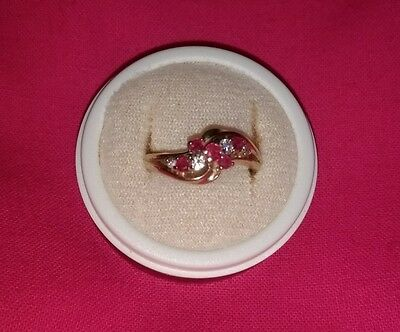 9k Ruby and diamond gold ring.
