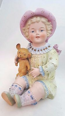 Vintage Bisque piano baby, girl with dog, unmarked
