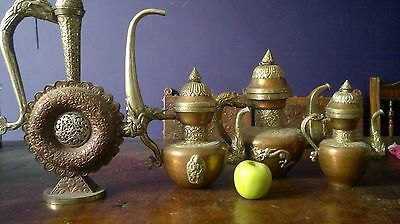 a set of 4 Tibetan silver and copper teapots or coffee pots