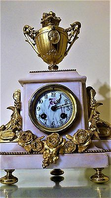 A 19th Century French Gilt and White Stone Mantel Clock.