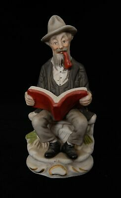 Unbranded Figurine of an Old Man Smoking While Reading
