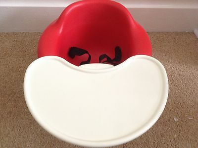 Baby Bumbo Seat In Deep Red  With Detachable Tray In Great Clean Condition.