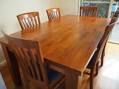 Timber dining table and 6 upholstered chairs