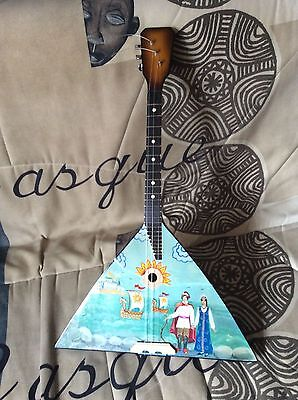Balalaika with a picture  3 three String Prima. Folk instrument, wood