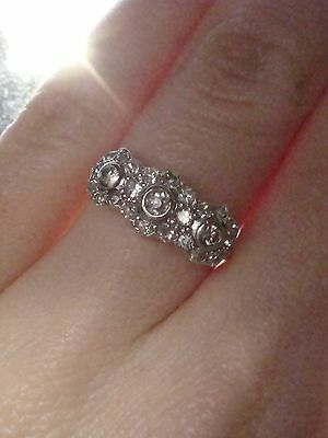 Edwardian 18ct platinum diamond flower pave set ring