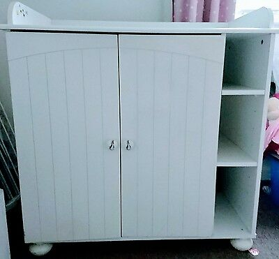 White baby changing unit with cupboard and shelves