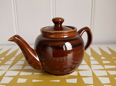 Splendid Vintage Teapot in a traditional style. Brown. classic. Retro Tea pot