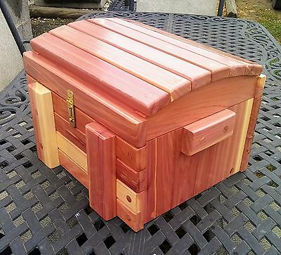 Cedar Chest round top with sliding interior drawer.