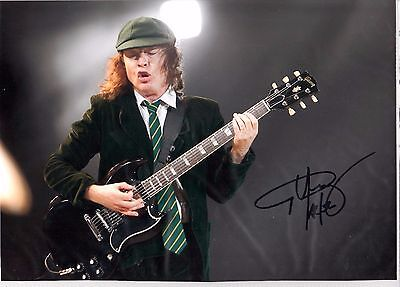 AC/DC - Angus Young Signed 8x12 Col Photo Signed Comes With coa