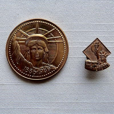 Lot of 2 The Nestle Company Statue of Liberty medal and pin