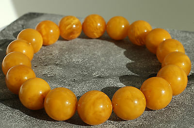 Antique baltic sea amber bracelet 16 grams, beeswax color.