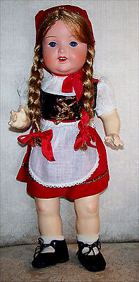 Composition doll in Original swiss style outfit. So cute! Glass sleep eyes.