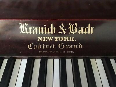 Upright grand piano, by Kranich & Bach made in NYC 1898