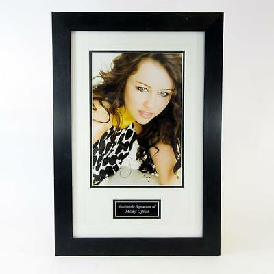 """Signed by Miley Cyrus - Autographed Framed Portrait Photograph - 21x14.5"""""""