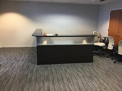 L Shaped Reception Desk, with dark wood and frosted glass.