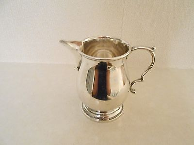 Sterling silver cream jugs