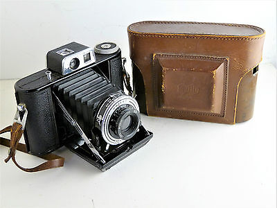 Agifold folding camera. 6 x 6 on 120. With leather case.